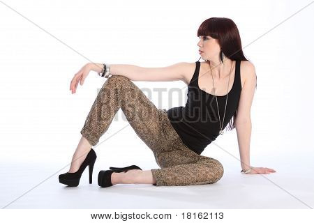 Sexy Leggy Fashion Model Sitting On Floor