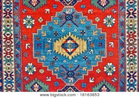 the colored wool ethnic handmade carpet closeup