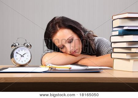Late Night Homework Woman Falls Asleep At Desk