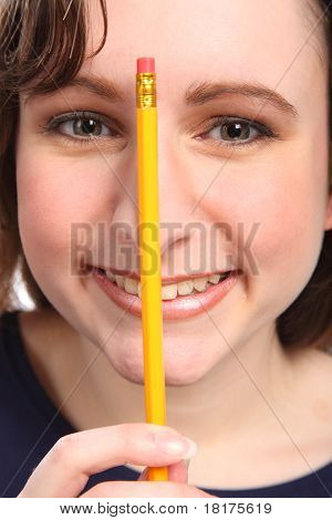Close Up Headshot Of Happy Young Girl With Pencil