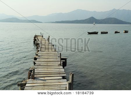 wooden pier with boats