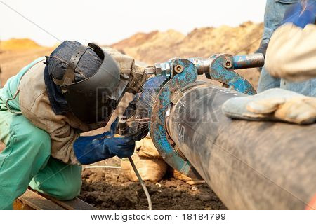 Pipeline welder working on construction site