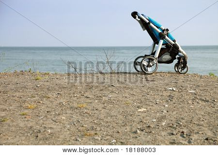 Empty Pushchair On Beach