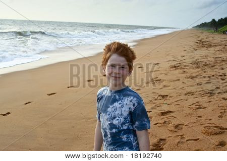 Child With Red Hair At The Beach