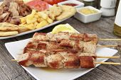 image of souvlaki  - Plate of traditional Greek pork skewer  - JPG