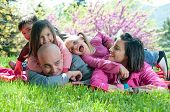 stock photo of family fun  - Happy family smiling and having fun outdoors - JPG