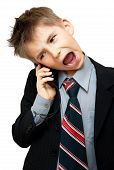 stock photo of baby-boy  - Boy In Suit Yelling Into Cellphone over white background - JPG