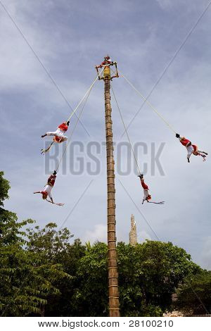 TULUM, MEXICO - AUGUST 10: Dance of Los Voladores the Totonac, performing ancient ritual on August 10, 2010 in Tulum, Mexico