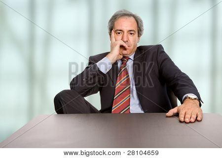 mature business man on a desk at the office