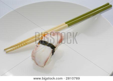 One Tako Nigiri Squid Sushi With Chopsticks