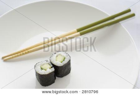 Two Kappa Maki Cucumber Rolls Sushi With Chopsticks