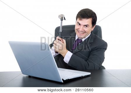 young happy business man with a hammer smashing a laptop