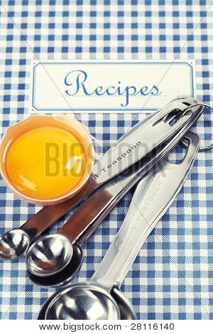 Blue cookbook and kitchenware