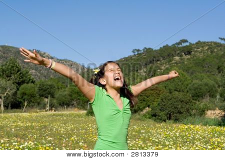 Happy Child Arms Outstretched With Joy