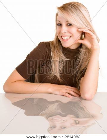 Smiling Blonde Lady Sitting At Her Desk
