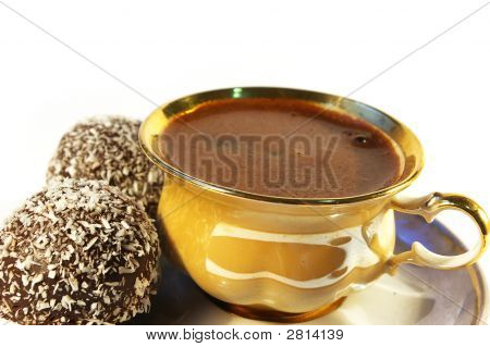 Cup Of Coffee And Sweet With A Coco