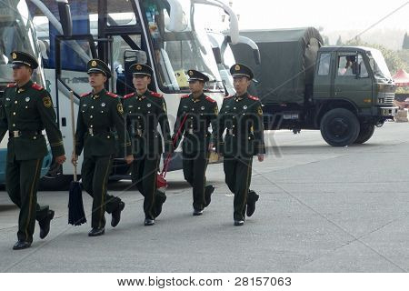 NANJING, CHINA - NOVEMBER 24: Soldiers on cleaning duty march to clean the Nanjing bridge office before a government official visit on November 24, 2011 in Nanjing, China.