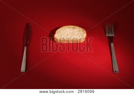Fork And Knife With Bread