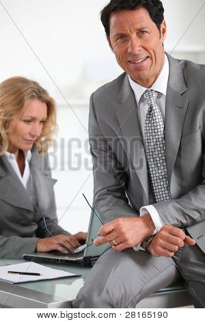 Businessman sat on desk