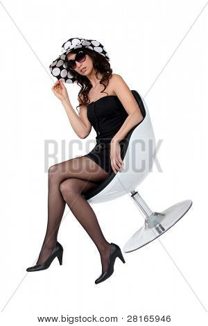 Dressy woman in a funky chair