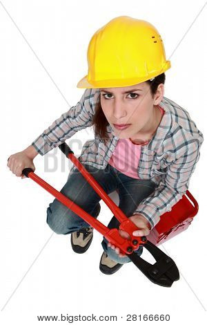 Woman with hard hat and bolt-cutters