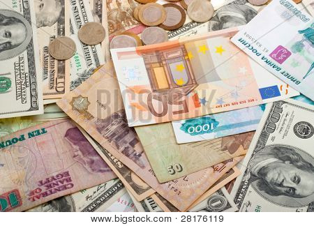 Collection of various money to background. Isolated on white.