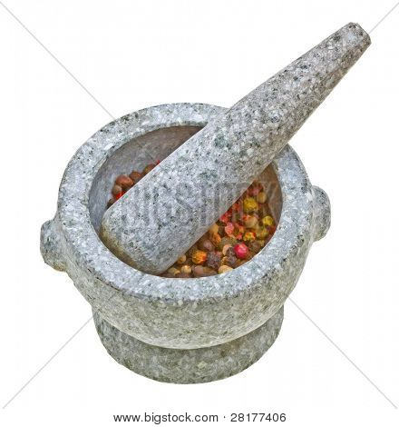 Close-up stone mortar and pestle with crushed pepper isolated on white background