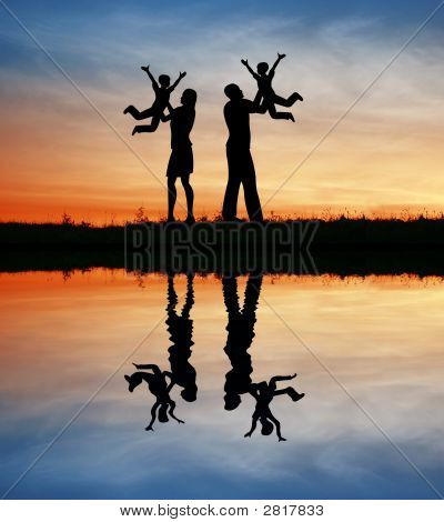 Family With Children On Hands Silhouette