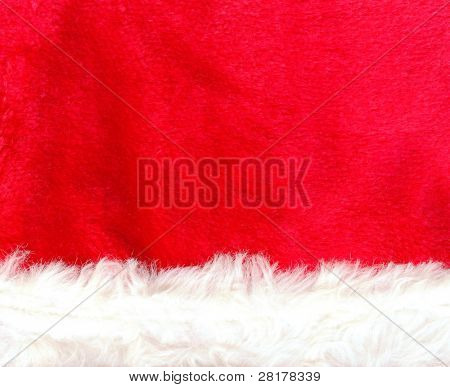 Close up red Santa Claus hat texture to backround