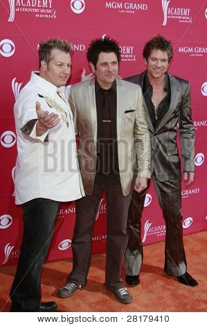 LAS VEGAS - APRIL 5: Gary LeVox, Jay DeMarcus and Joe Don Rooney of Rascal Flatts at the 44th annual Academy Of Country Music Awards held at the MGM Grand on April 5, 2009 in Las Vegas, Nevada