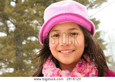 Child Smiling Outdoors In Winter