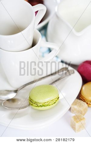 Espresso cups and fresh colorful macaroons