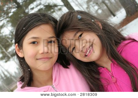 Two Girls Enjoying The Winter
