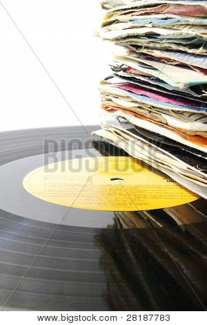 Pile of old vinyl records on an LP.