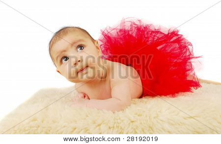 A Beautiful  Ballet  Baby Laying On A Fur Rug