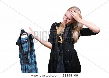 Woman Chooses Between Two Dresses