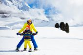 Family Skiing In Mountains. Mother And Kid Ski. poster