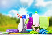 Cleaning Concept Of Cleaning Supplies Needed To Spring Cleaning. Cleaning Equipment At Spring Backgr poster
