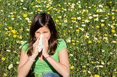 stock photo of allergy  - child with hay fever allergy blowing nose and sneezing - JPG