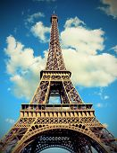 Eiffel Tower Also Called Tour Eiffel In French Language With Toned Vintage Effect And Many Clouds poster