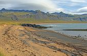 Golden Sand Beach With Lava And Mountains Near Budir, Iceland On The Snaefellsnes Peninsula. poster