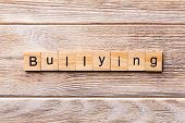 Bullying Word Written On Wood Block. Bullying Text On Wooden Table For Your Desing, Concept poster