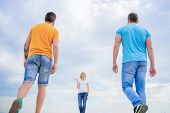 Summery Fresh And Brigh. Pretty Woman And Men Friends Walking Outdoor. Fashion People Look Casual In poster