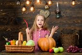 Girl Kid At Farm Market With Fall Harvest. Child Little Girl Celebrate Harvesting. Kid Farmer With H poster