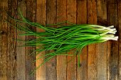 Green Onion Bunch On Wooden Table Background. Fresh Green Onion For Salad On Rustic Wood. Closeup Gr poster