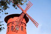 stock photo of moulin rouge  - Le Moulin Rouge cabaret in Paris France - JPG
