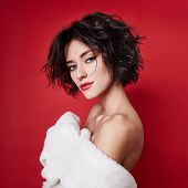 Sexy Woman With Short Hair Cut In White Sweater On Red Background. Perfect Girl With Wet Tousled Dar poster