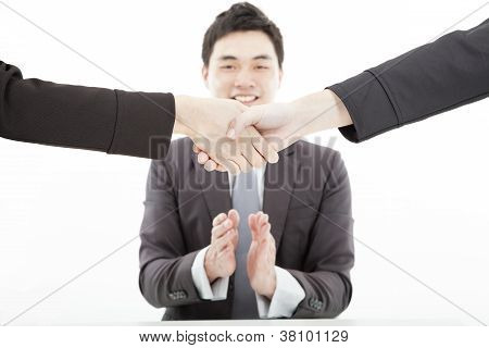 Handshaking Against Businessman Applauding Hands