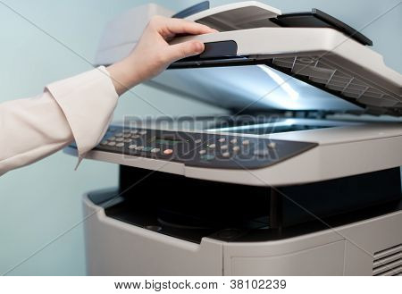 Woman's Hand With Copier (focus On Finger)