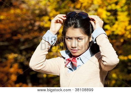 Pretty Asian Woman In Autumn